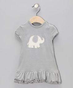A sweet, silky feel, cuddly appliqué and ruffled hem give cuties plenty to love about this darling organic dress. With a simple pullover design, getting ready for a day of precious fun is quick and convenient.