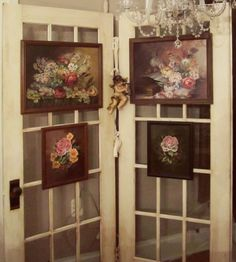 door used as a backdrop for art.  These look exactly like the doors in my dining room!