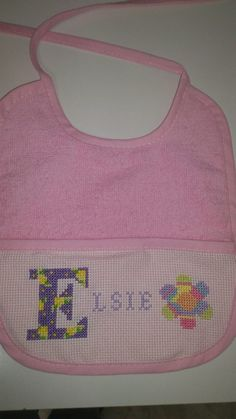 Bib I made. I personalise them for $9.95. They can be done in pink, blue, pale green, pale yellow or white with any personalisation.  Custom Cross Stitch Creations on Facebook.
