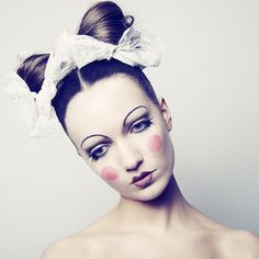 Doll Make-up - A more classic and avant-garde interpretation of doll make-up and hair. It has the traditional 1920 thin brow with heart shaped lips. It also incorporates rosy cheeks. This make-up is similar to 18th century make-up with the pale skin and stark blush.