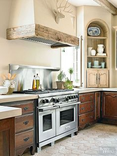 One of the drawbacks of reclaimed wood is that you get only what's available. However, small pieces can be used in interesting ways to lend history to revamped spaces. Here, traditional details in a kitchen are supplemented by a notched, split, and perfectly executed reclaimed wood vent hood frame./