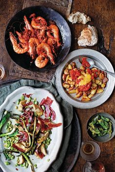 Try one of our tapas recipes including king prawns with garlic and chilli, tortilla, calamari with romesco sauce and a chickpea and chorizo stew. Calamari, Prawn, Chorizo, Paella, Finger Foods, Yummy Food, Treats, Snacks, Dinner