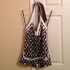 Bebe reversible tie neck halter This halter top is reversible! Ties around the neck and has a zipper on the side. Brown and cream. Great condition! bebe Tops