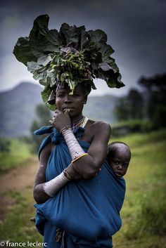 Surma Woman, Omo Valley - A young Surma woman with her child, Omo Valley, Ethiopia