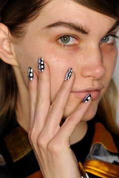 A model rocks CND nails, made in collaboration with Naomi Yasuda, inspired by Spike Jonze's photography for Opening Ceremony's F/W 2015 #NYFW runway. #OpeningCeremony #CNDatFashionWeek