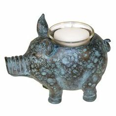 """Mottled blue and copper pig-shaped candleholder.          Product: Candleholder    Construction Material: Glass and composite wood    Color: Blue and copper        Accommodates: (1) Candle - not included  Dimensions: 4"""" H x 6.5"""" W x 3"""" D"""