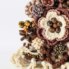 Unique crochet beaded cuff with semi precious stones and crystals.