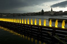 34 lit penguins on the river by cracking art