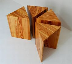 I am on the hunt for a very simple nightstand - just room to set my glasses and Kindle on at night.  I was thinking of a floating shelf, but I like the look of these too...