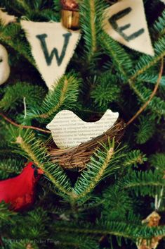 DIY Book Page Bird Ornament - I think I know what I'll do with some of those nests --- the burlap banner in the background is cute too  ********************************************  At The Picket Fence - #Handmade #Christmas #ornament #book #page #bird #nest #crafts - tå√