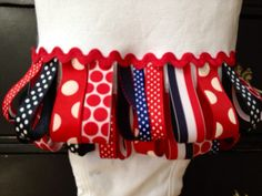 Oh So Cute and Perfect for the summer! Ric Rac flag on the front. 4th of July Looped Ribbon Onesie by SweetTootsy on Etsy, $35.00