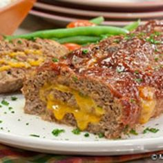 Cheesy Stuffed Meatloaf   - Think I'll make this for dinner this week :)