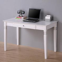 This desk features a stylish modern design, a rich solid wood finish, and intricate scrollwork on the legs and panels. The size of the desk provides for maximized workspace and it features a drop down keyboard tray for your convenience.