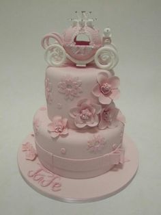 Beautiful pinks princess carriage cake with adorable flowers