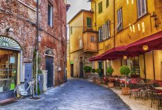 Get lost in the labyrinth of cobblestone lanes that sit within the well-preserved walls of one of Tuscany's most charming cities, Lucca.