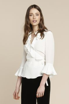 A sartorial classic, our wrap top is a wardrobe must. Perfect worn with jeans or our Velvet Trousers, the ruffle collar and double cuff make for wonderful details.