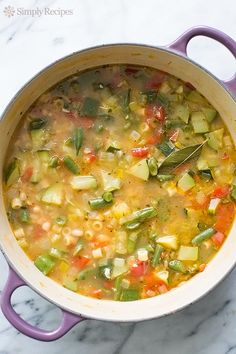 Summer Minestrone Soup ~ Minestrone soup featuring fresh summer garden vegetables! With zucchini, tomatoes, green beans, celery, bell pepper, chicken stock, white beans, and pasta. It's summer in a soup! ~ SimplyRecipes.com