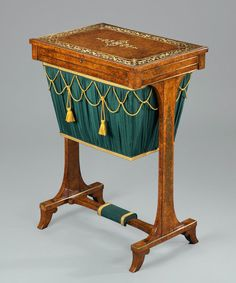 By Regency period work / sewing tables were invariably designed with end-supports, a pleated silk bag and a stretcher below. Early in this period it might have a simple line inlaid into the veneer but after 1810 inlay became more complex and imitated French Buhl-Work as here.  English, Circa 1810