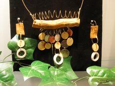 Conjunto confeccionado con raíz de calafate, cobre, plata y bronce $135.000 (2500411114)(roca)