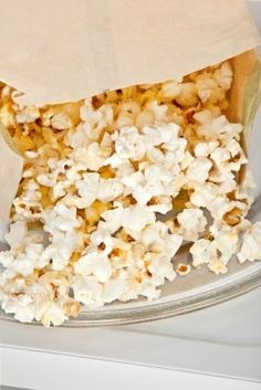 This is a guide about removing burnt popcorn smell and stains from a microwave. Overcooking popcorn in the microwave can result in a burnt odor and staining.