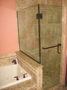 Shower door is hinged off of the glass and off of the tiled wall. The glass-to-glass hinge is a 90 degree hinge with a knee wall adjustable ...