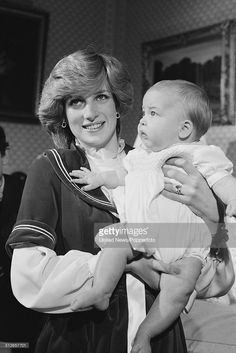 Diana, Princess of Wales (1961-1997) holds her baby son, Prince William at Kensington Palace in London on 22nd December 1982.