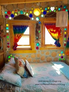 The Mermaid Cottage is a Tiny Romantic Getaway - Tiny HousesWe show you beautiful cordwood homes and teach you how to build them. Private retreat located near Del Norte, Colorado. Filled with beautiful original art and mermaids!Hammer out old copper penni Bottle House, Bottle Wall, Cordwood Homes, Earthship Home, Tadelakt, Natural Homes, Earth Homes, Natural Building, Glass Bottles