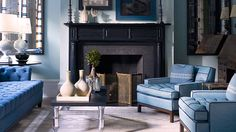 black fireplace, blue wall, white trim-  Get Inspired: Black Fireplaces and How to Style Them