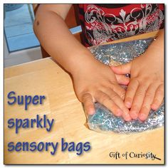 """Super sparkly sensory bags - freezer bags, blue hair gel, glitter & two kinds of beads ("""",)"""