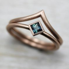Our 3mm Oblique Square Solitaire Engagement Ring, made from eco-friendly, recycled 14k Rose Gold and a fair trade denim blue Australian sapphire.