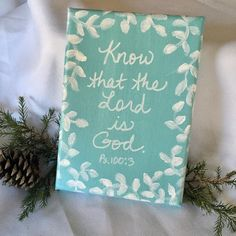 """Mini canvas with """"Know that the Lord is God"""" handwritten words from Psalm 100:3 scripture. Turquoise background with white vines and leaves. Design wraps around sides. Stands alone or can be placed on an easel for display. Signed by the artist on the back. Perfect for your desk, bookshelf, kitchen windowsill, etc. sarahgeringer.com #christianart #christmasgift #psalm100 #minipainting Women Of Faith, Faith In God, Psalm 100 3, Christian Meditation, Strong Faith, Inspirational Verses, Turquoise Background, Meditation For Beginners, Mini Canvas"""