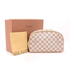48a1eb1699a2 Authentic Louis Vuitton white damier Azur canvas cosmetic pouch bag with  leather trimmings and features a