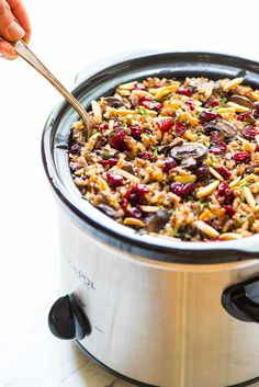 The BEST gluten free stuffing: Crockpot Stuffing with Wild Rice, Cranberries and Almonds. Easy slow cooker recipe that our whole family loved! Can be made ahead and frees up the oven, so it's the perfect holiday and Thanksgiving side dish. {vegan, gluten free} Recipe at wellplated.com | @wellplated