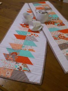 Two simple table runners made from one charm pack.