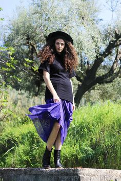 The purple cowboy, maxi hat, purple skirt and ankle boots