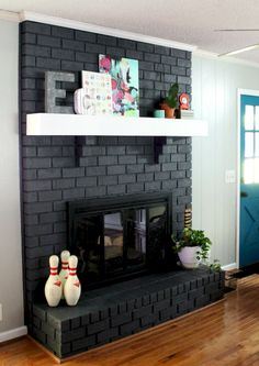 Newest Photographs brick Fireplace Design Concepts Whether or not your home is throughout Aspen or Ca, there is no not accepting your encouraging effect of a comfortable o Black Brick Fireplace, Painted Brick Fireplaces, Paint Fireplace, Brick Fireplace Makeover, Home Fireplace, Modern Fireplace, Fireplace Surrounds, Fireplace Design, Black Fireplace Surround