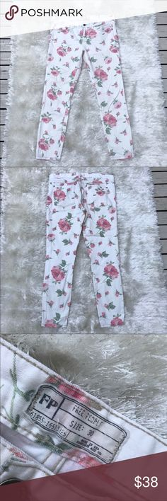 """FREE PEOPLE Rose Print White Jeans Floral print Free People straight leg skinny white jeans. Pink and red roses with green leaves. Approx. waist is 16.5"""" laid flat and approx. inseam is 27"""". Would look amazing with a chunky sweater. Free People Jeans Straight Leg"""