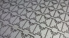 CNC punched zintec sheet metal brackets still in CNC nest.  http://www.vandf.co.uk/plant-list/trumpf-3000r/