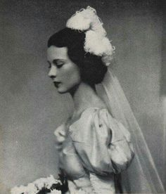 I know, it's NOT from a movie but she's one of the most beautiful Classic Stars- A rare photo of Vivien Leigh at 18 years old when she was presented to the English Court- 1932-