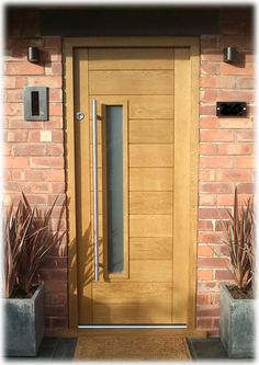 Oak contemporary front door...a combo of vertical & horizontal details..nice!