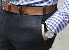 Dark grey trousers and brown belt