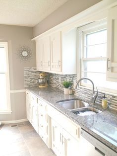 Sherwin Williams Functional grey...bathroom?  This will be darker in your bathroom because of the dark wood and no windows.