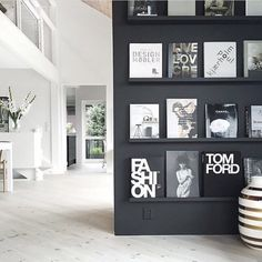 Need this wall in our home pronto! Our Tom Ford Coffee Table Book has never looked so good. www.whiteandco.com.au
