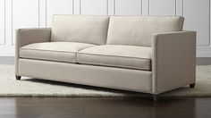 We designed Dryden so you can make it yours. Sofa's sheltering track arms frame upright, comfortable seating for the living or family room, upholstered in your choice of two decor-friendly fabrics—a subtle, diamond-textured weave or velvety-soft microfiber.