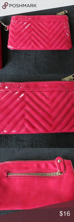 Big Buddha Pink Pleather Small Wristlet Wallet Very cute small wristlet style purse from Big Buddha company.  Pleather pink with a sewn herringbone chevron pattern on the front.  Paisley style satin lining inside with the logo tag.  Very minimal wear (no wear or damage noted). Retailed around $25 Big Buddha Bags Clutches & Wristlets