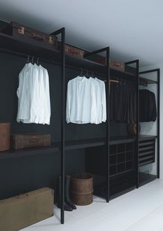 black walk in closet - Porro's modular closet designed by Piero Lissoni.