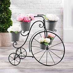 This Galvanized Metal Tricycle Planter will make your backyard feel like a flower market. Metal Art Projects, Metal Crafts, House Plants Decor, Plant Decor, Metal Planter Boxes, Planters, Metal Raised Garden Beds, Wrought Iron Decor, Metal Plant Stand