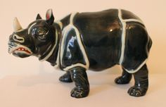 A unique and excellent majolica rhino figurine by Bohemian manufacturers Gerbling and Stephan circa 1865. Factory marks to the base reads: G & St, 2393. The item is in excellent condition, measuring approximately 9.5 inches in length by 6.5 inches in height. Please note that this item is not in our shop so if you would like to view it, please let us know and we can make arrangements to bring it into Retriques.