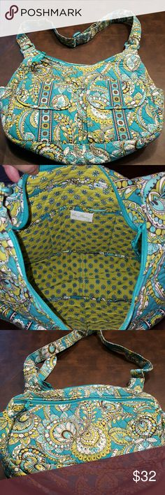 NEW ARRIVAL 🛍Vera Bradley Paisley Hobo Bag Gorgeous teal and green shoulder bag from Vera Bradley. Interior zipper section with 3 pockets. Exterior zipper pocket and 2 front velcro pockets. 17in x 12in.  EUC. Still stiff and lightly used. Vera Bradley Bags Shoulder Bags