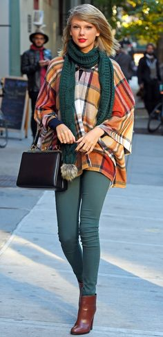 Taylor Swift ; Out and about, New York, November 2014 ; Topshop cape, Hudson Jeans skinnies, Prada boots, Dolce & Gabbana bag & Topshop scarf